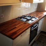 Fitted kitchen from scratch, including cupboards, counter top, appliance fitting, wall tiles.